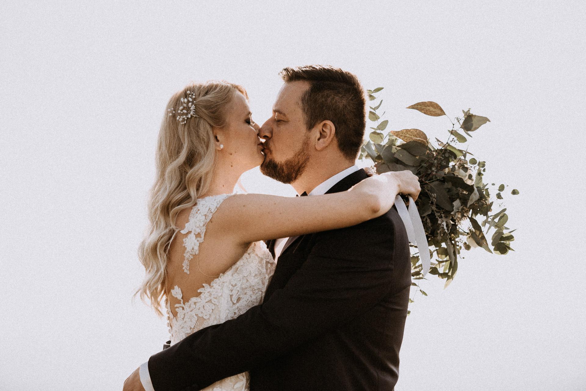 couple shoot bride groom kiss