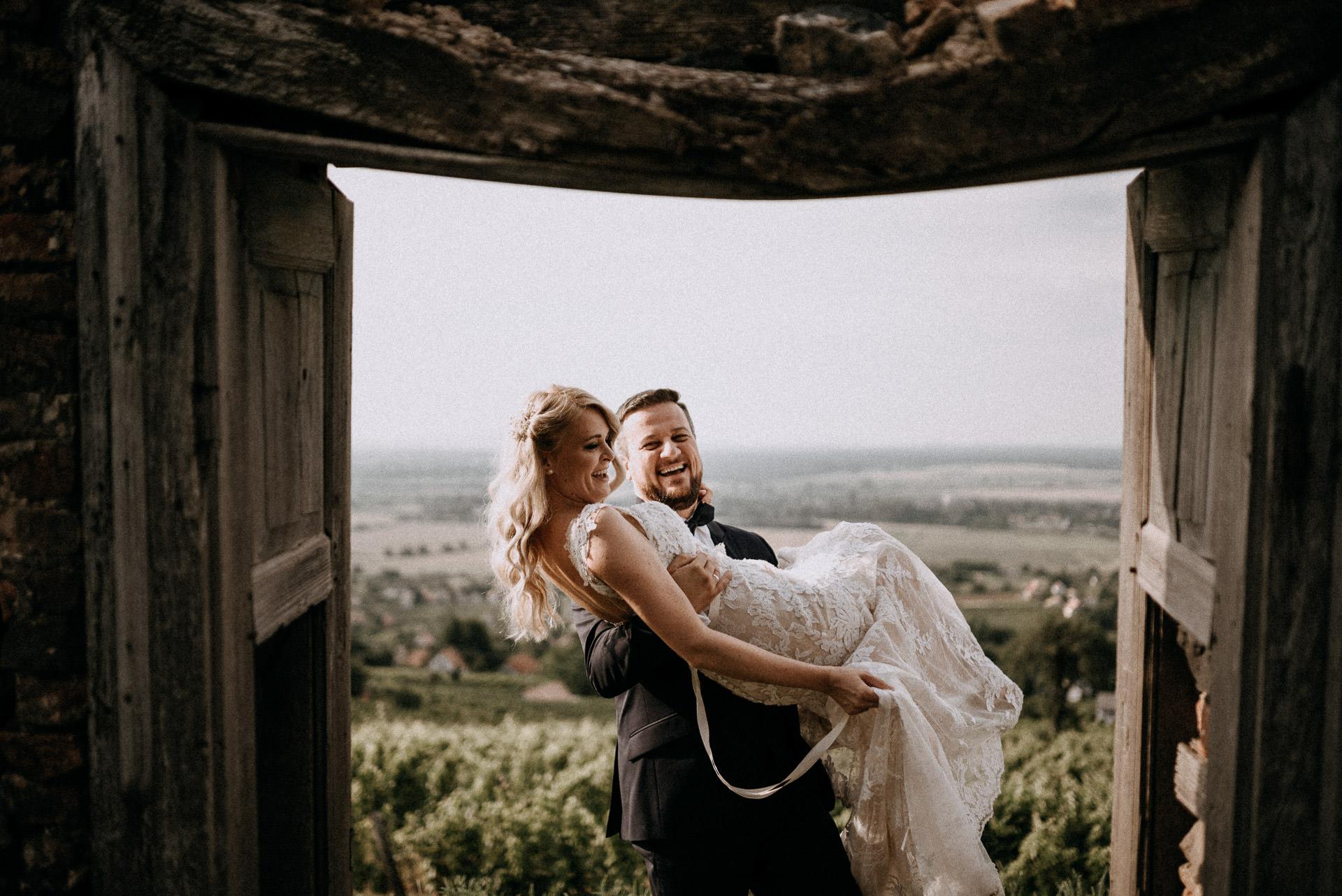 laugh bride groom door