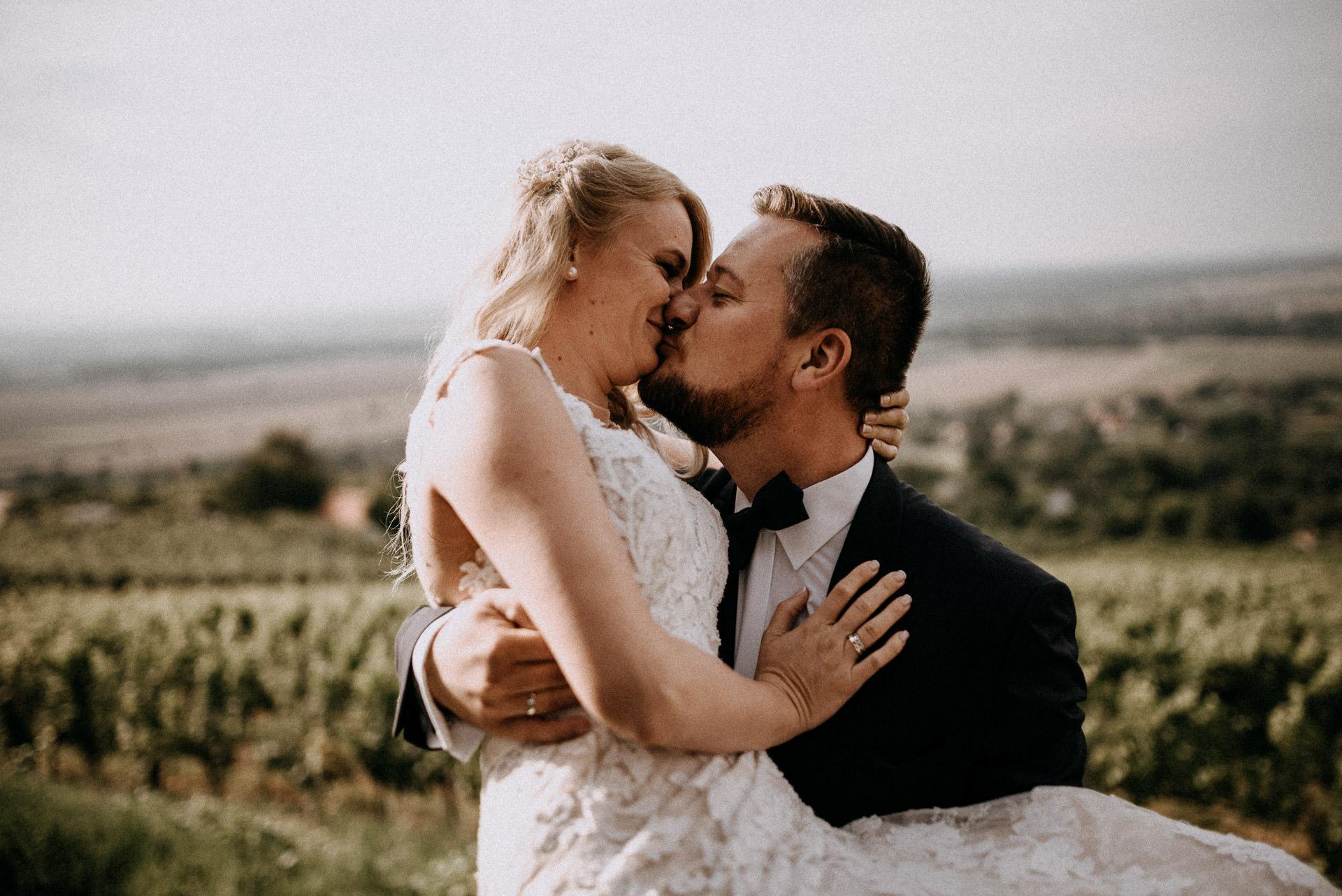 kiss bride groom smile